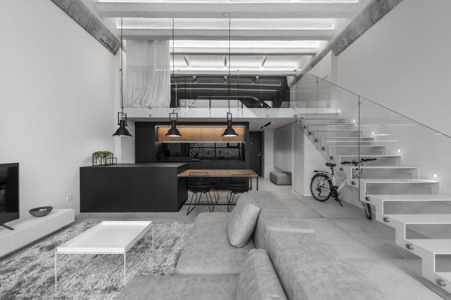 Minimalism și industrial loft – simplitatea brută într-un singur apartament