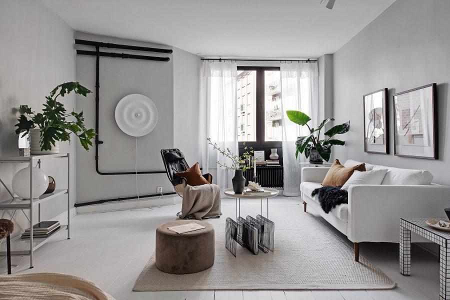 Apartament în stil scandinav, în alb, gri și accente de negru